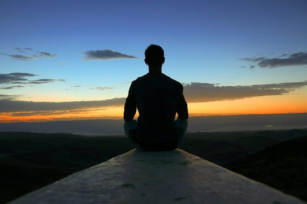 A man meditating - Easy way to boost your mood meditation